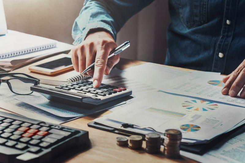 man using calculator in financial office