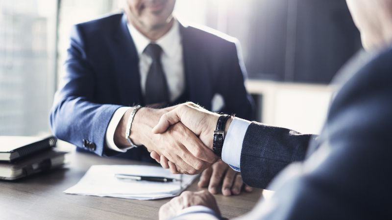 business resolution with men shaking hands