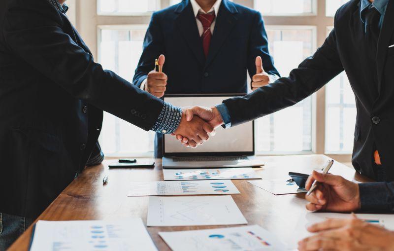 men shaking hands over business deal